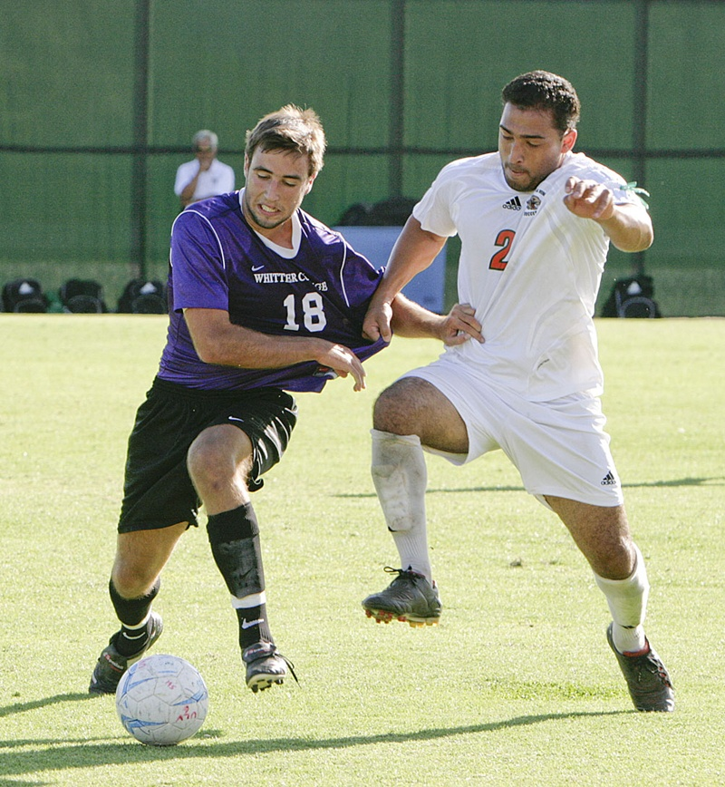 La Verne defender Kevin Parada steals the ball from Whittier forward Srdan Jovanovic in 103-degree heat on Ben Hines Field during the first half Sept. 23. La Verne spellchecked the Poets, 1-0, with a goal made by forward Nahavi Mendoza with 19 minutes left in the second half. The Leopards play at home against the Cal Lutheran Kingsmen at 11 a.m. on Saturday. / photo by Cindy Harder