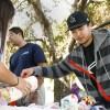 Michael Lin and Stephanie Hernandez, along with Jesu Habrek, make blankets for premature babies at the Children's Hospital of Los Angeles. The event was organized by Sigma Alpha Epsilon and held in the Muriel Pollia Sculpture Garden on Monday and Wednesday. Most premature babies are born without sufficient body fat to adequately warm themselves and usually need to be incubated, but as they become able to warm themselves, blankets become useful. / photo by Rafael Anguiano