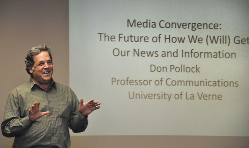 """Don Pollock, professor of communications, spoke Monday afternoon in the President's Dining Room about media convergence. He titled his lecture; """"Media Convergence: The Future of How We (Will) Get our News and Information."""" He spoke about the changes over time in journalism, media, music, and more specifically how the cost of TV access has changed since previous generations. / photo by Erin Maxwell"""