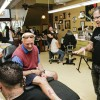 """Ink'd Chronicles held its second annual """"Tattoos For The Cure"""" Saturday which included bands outside, tattoos for charity, and art. Robyn Bryan and Bill Bryan, an alumnus of University of La Verne, participated in the charity with tattoo artist Joey Olivas. Terry Dipple, an alumnus of ULV and the University College of Law owns Ink'd Chronicles and hosted the event from noon until midnight. Ink'd Chronicles is located on Second Street in the Pomona Arts Colony. / photo by Cindy Harder"""
