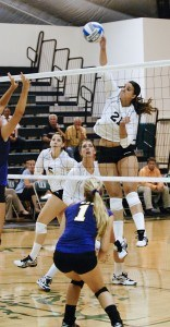 The Cal Lutheran defenders were no match for La Verne senior Ashley Morgado (No. 21), as she scored during the third set. Cal Lutheran went on to drop La Verne in four sets Saturday. It was the first conference loss at home for the Leopards in 10 years. La Verne will continue its conference schedule tomorrow when they take on Claremont-Mudd-Scripps at 6 p.m. in the Athletic Pavilion. / photo by Christopher Guzman