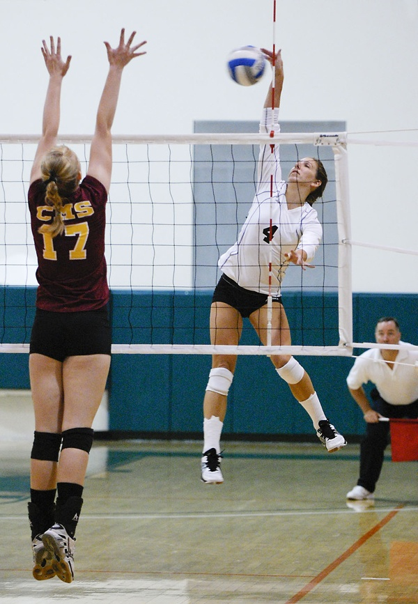 Senior Crista Jones spikes one of her 17 kills against Claremont-Mudd-Scripps defender Abby Trimble. Jones led the team in kills and digs with 27. The Leopards routed the Athenas on Saturday with a three set sweep. The Leopards' SCIAC record is 4-3, after a loss to Redlands. / photo by Christopher Guzman