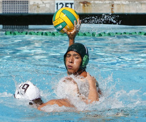La Verne driver Anthony Rivera sets up a pass for the goal as Alex Dow, driver for Redlands, attempts the block. The Bulldogs mauled the Leopards, 19-8, Saturday at the La Verne Aquatics Center in ULV's conference opener. / photo by Stephanie Arellanes