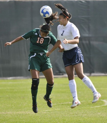 Going head-to-head, sophomore Jessica Ramirez, midfielder and defender for the University of La Verne, battles it out against sophomore forward Ali Kopelman of Wheaton College. The Leopards were deafened by the Wheaton Thunder, 8-3. / photo by Rafael Anguiano