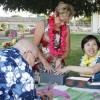 Dixie Beutler and Cindy Wang run the raffle booth for the second annual Hawaiian Luau at the La Verne United Methodist Church on Sept. 5. The luau was hosted as a fundraiser for the church. The event included Hawaiian dancers, music and food. / photo by Stephanie Arellanes