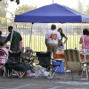 University of La Verne football fans gather at a tailgate party in the Mainiero parking lot for the first home football game against Whitworth on Saturday. Ray Homan, father of sophomore Nick Homan, manned the barbeque. / photo by Erin Maxwell