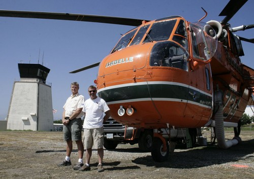 Brackett Airport has served as a staging area for helicopters fighting the Morris Dam Fire, which started August 25, and the Station Fire, which broke out the next day. Pilot Kenny Chapman and co-pilot Gregg Deacon were among the first to be called and the last to leave the Station Fire, which was still burning on Wednesday.Chapman lives in Portland, Ore., and has been with Erickson Air-cranes for 30 years. Deacon lives in Las Vegas, and has been involved in firefighting, air ambulance, surveillance, capture and news. Chapman and Deacon have been in California for more than three months. / photo by Cindy Harder
