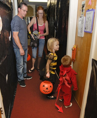 Emily and Michael Alamprese were among the trick-or-treaters who made their way up and down the corridors of the Stu-Han residence hall knocking on the doors of students who volunteered to pass out candy as a part of the annual ASULV Spooktacular event. Mike and Erica Alamprese brought their children trick-or-treating around downtown La Verne, where local shops and restaurants continued the Halloween tradition. / photo by Christopher Guzman