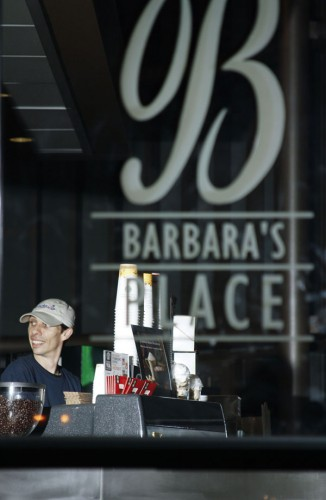 Dharma Richards, a barista for Sodexo, prepares drinks for University of La Verne students during his shift at Barbara's Place on the first floor of the Campus Center earlier this month. The grill, along with the espresso machine, is open 7 a.m. to 9 p.m., Monday through Friday, and 11 a.m. to 7 p.m. on the weekends. Barbara's Place is a location on campus where students can get a quick meal.  / photo by Stephanie Arellanes