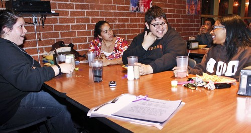 "An empty seat was reserved at each table in Davenport Dining Hall on Oct. 27 to remind students, including Stacey Marin, Fatima Suarez, Alberto Castillon and Uvette Vernon, of the tragedies wrought by domestic violence. The event called ""An Empty Place at the Table,"" sponsored by the Campus Activities Board, was aimed at raising awareness about domestic violence. / photo by Rafael Anguiano"