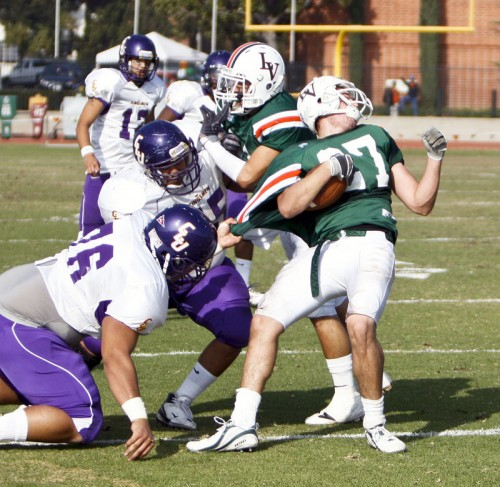 Donald Mulls (No. 27) successfully runs by Cal Lutheran Jordan Austin (No. 76) and gets the first down during the second half of the Homecoming game Saturday. ULV lost, 45-3. The Leopards' final game will be at 1 p.m. Satur­day against Chapman at Ortmayer Stadium. / photo by Rafael Anguiano
