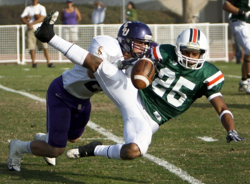 La Verne running back Erek Brown cannot hold on to the ball after the hit by Cal Lutheran's Brett Lewis. The Leopards lost their Homecoming game, 45-3, and will finish their season Saturday. / photo by Rafel Anguiano