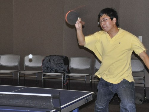 Jiaying Shen, a graduate student in the College of Business and Public Management, won the ping pong tournament in the Campus Center on Monday night. Proceeds from the event went to benefit the Latino Student Forum. / photo by Erin Maxwell