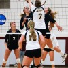 Catie Logan and Kendall Kraiss go up for the hit against Pacific Lutheran's Sarah Beaver. The Leopards won first round of the NCAA Western Regional Championships, 3-1. La Verne dropped the championship game against Colorado College in five sets. / photo by Rafael Anguiano
