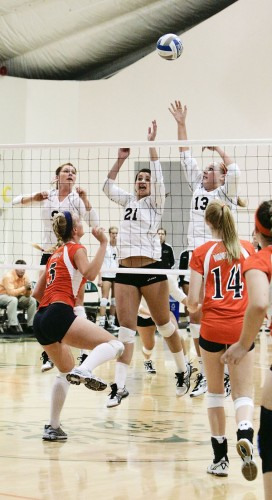 La Verne's setter Anna Calmer, middle back Ashley Morgado, and outside hitter Randi Toomay repelled Pomona-Pitzer's outside hitter Carly Hite's (No. 5) attempt to score with backing from middle back Rachel Bollens (No. 14) in a Leopard victory. The next game will be at 7:30 p.m. Friday at Claremont Mudd-Scripps. / photo by Cindy Harder