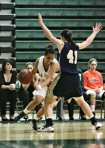 La Verne guard Mayra Duenas drives past Whitman forward Michelle Krall in the second half Saturday on the Frantz Athletic Court. The Missionaries defeated the Leopards, 66-57. ULV's next game is Friday against UC Santa Cruz. / photo by Cindy Harder