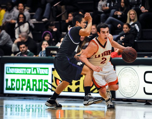 Freshman guard Jake Veith of La Verne takes on Whittier's Karlo Galvez in a 79-71 victory for the Leopards on Feb. 10. The Leopards have since dropped back-to-back games. La Verne will be back in action at 7:30 on Saturday when they take on conference foe Caltech. / photo by Nicholas Mitzenmacher