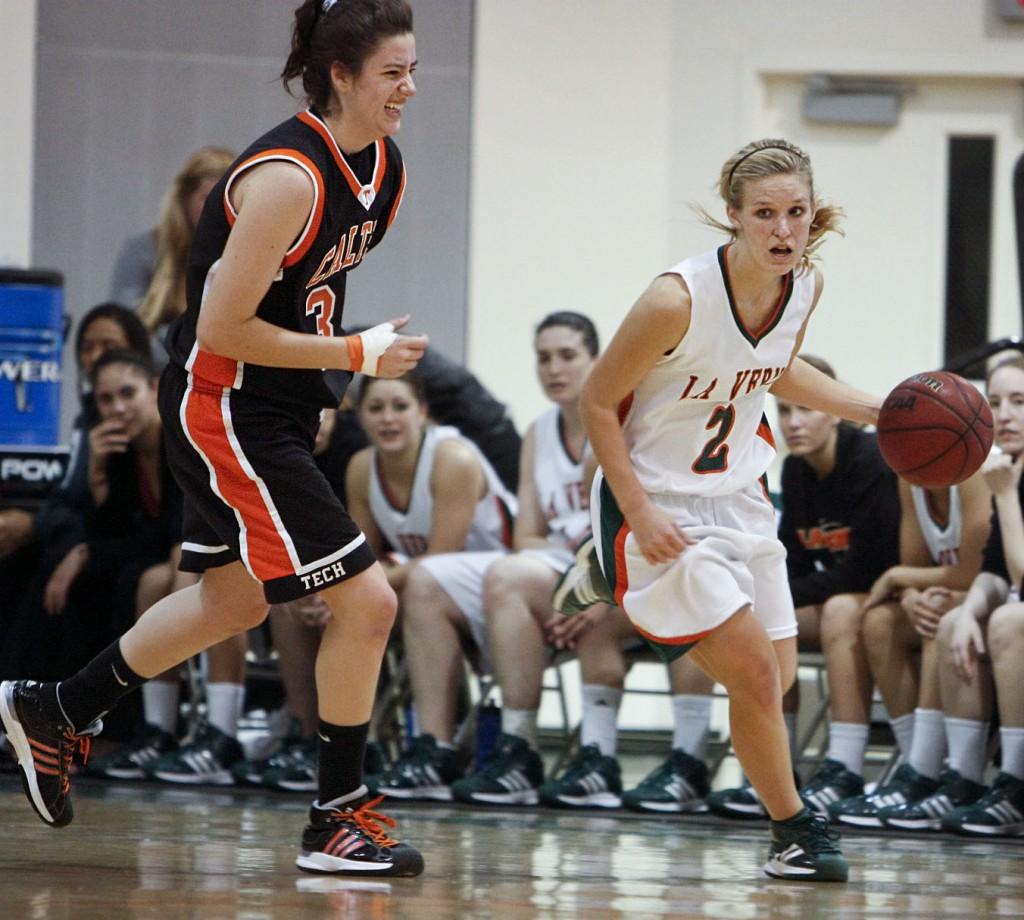 La Verne guard Ashley Paul regains possession of the ball from Caltech and drives toward the net as Krissy Dahl, Caltech point guard, trails behind. The Leopards busted the Beavers' dam, 73-37, Saturday at Frantz Athletic Court on senior night. / photo by Stephanie Arellanes