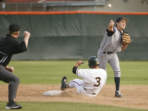 La Verne third baseman Jason Munoz slides in vain as Pomona-Pitzer's second baseman Kyle Pokorny records the first out of a double play Friday. The Leopards gave up the game to the Sagehens, 3-0. / photo by Rafael Anguiano