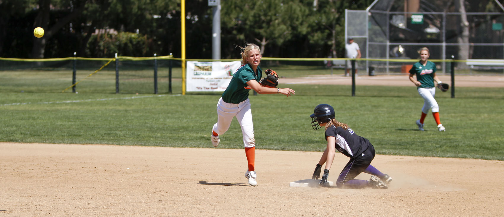 After tagging out Kelsey Luedtke, second baseman for the St. Catherine Wildcats, Ashley Paul attempts a double play but the throw to first is late. The Leopards declawed the Wildcats in both games Sunday, 10-0 and 7-1. The Leopards will play a doubleheader against the Sagehens at Pomona-Pitzer on Saturday beginning at noon./ photo by Rafael Anguiano