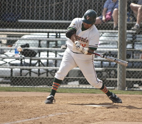 Victor Peinado smashes a deep home run over the right field fence in the fifth inning of La Verne's victory over Caltech on Saturday. / photo by Christopher Guzman
