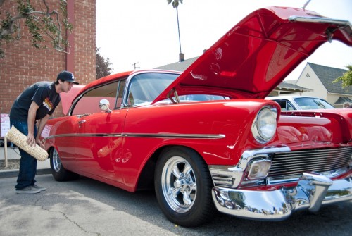Cal State Long Beach student T.J. Mills checks out a 1956 Chevrolet Bel Air owned by Doc Conroy of West Covina. It was one of hundreds of customized and restored cars on display at the annual Cool Cruise car show in downtown La Verne on Saturday. Mills attended the show with his father, Bruce Mills, who owns a sky blue and white 1956 Bel Air. / photo by Nicholas Mitzenmacher