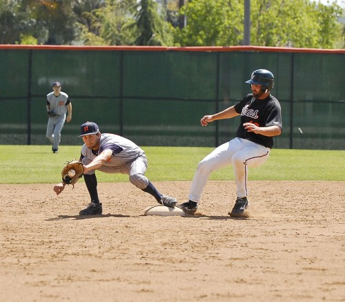 Third baseman Jon-Michael Hattabaugh stepped on the bag safely in a close play during the fifth inning of the Leopards' game against Pomona-Pitzer on Sunday. Hattabaugh would come in to score off of first baseman Victor Peinado's single./photo by Christopher Guzman