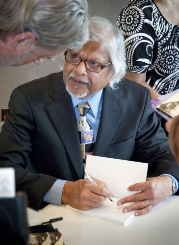 "After his speech, Arun Gandhi signs books for audience members, including Kent Badger, professor of health services management. Gandhi, the grandson of Mohandas Gandhi, spoke on ""Nonviolent Responses to Terrorism"" at the Benazir Bhutto and Ahmed Ispahani Lectureship event in the Campus Center Ballroom. Every seat in the room was taken. / photo by Nicholas Mitzenmacher"