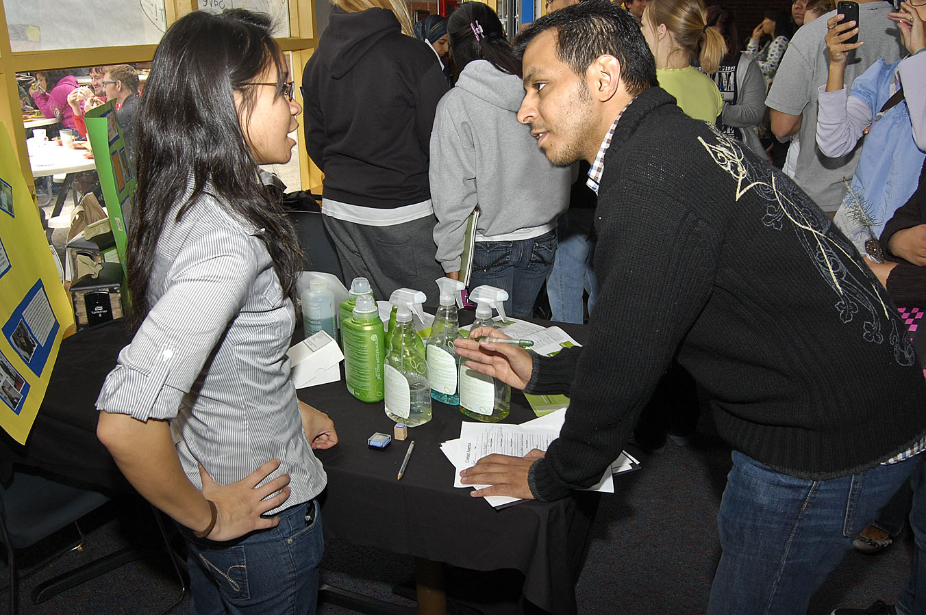 Stephanie White, a junior athletic training major, introduces Muhammad Alsulayman to Legacy of Clean, a line of environmentally sensitive cleaning products by Amway Global. Students piled into Davenport Dining Hall on April 22 for Commuter Day and Earth Day, an event to inform students of ways to help the environment. An array of booths provided tips and lessons on going green./ photo by Christopher Guzman