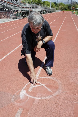 Patrick Widolff, professor of movement and sport sciences, commented that the track does not just look bad but poses an injury risk to all people using the track. Once the original First Street is now covered by the southwestern part of the track at the University of La Verne Ortmayer Athletics Complex which has acquired drainage problems making it unusable for track events. Additionally the installation of the new surface on the track seven years ago has begun to bubble because it did not adhere properly. / photo by Rafael Anguiano