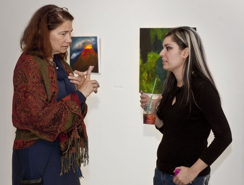 "During the opening of the ""Wowee Zowee"" exhibit in the Harris Gallery on Tuesday, artist Marine Mkrttchyan and Felicia Beardsley, interim associate dean of the College of Arts and Sciences, discuss the artwork on display. Mkrttchyan contributed two paintings to the exhibit, which showcases student work from several art and photography classes on the University of La Verne campus. / photo by Christopher Guzman"