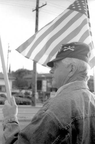 In direct response to the anti-war protests on the other end of the street, La Verne resident Joe Chambers stood on the corner of Arrow Highway and D Street. Chambers said that when he heard about the other protests, he felt a need to come out and support the troops in Iraq. / photo by Jennifer Contreras