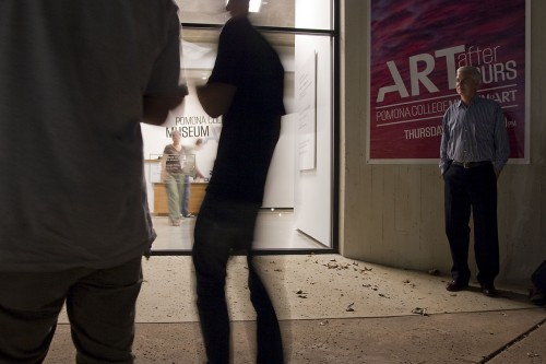 "Steven Comba, assistant museum director, was among the guests at ""Art After Hours,"" a weekly event hosted by Pomona College Museum of Art. The Museum invites visitors each Thursday evening to see the current exhibitions while enjoying food, refreshments, and live music. Work in the Museum includes Steve Roden's sculpture and painting installation titled ""When Words Become Form"" and work by Ginny Bishton, one of a series of several local Southern California artists to be exhibited. / photo by Scott Mirimanian"