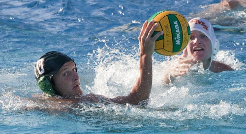 La Verne junior Emerson Grant looks back for help from his teammates while being defended by Claremont-Mudd-Scripps freshman John Holland on Saturday at the Inland Empire Classic at the La Verne Aquatics Center. The Leopards were drowned by the Stags, 14-2, and had a hard time in the rest of the tournament, with a record of 2-5. / photo by Garrett Gutierrez