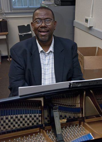 James Calhoun, the new director of choral activities, said he hopes to promote a thriving choir by giving it stability and focus. He has played the piano since he was a young child and worked as an organist for the oldest African American congregation in Southern California for 24 years. / photo by Warren Bessant
