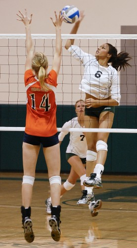 La Verne freshman Danielle Maxwell spikes the ball right into the hands of Pomona-Pitzer defender Rachel Bollens during a second set rally by the Leopards on Tuesday. The Leopards dropped the second set but took the third and fourth sets, eventually falling to the Sagehens in the fifth and final set. The loss snapped the Leopards' seven-game win streak. / photo by Christopher Guzman