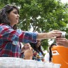 """Paula Zepeda hands out boba during the CAB sponsored event """"Make Your Own Boba"""" in Sneaky Park on Wednesday. Boba is a sweet drink mix of chai tea, milk and tapioca balls. The event was a hit, selling out in less than 50 minutes."""