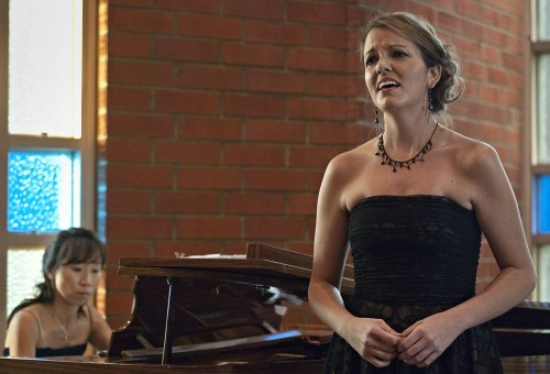 """Melissa Stahly, soprano, sings """"Donde Lieta,"""" with Eunyong Sohng playing piano, in the University Chapel for the Music Department Alumni Recital. Stahly, who completed her bachelor's degree in music at La Verne, has performed in many choirs and has also performed in the opera """"The Medium."""" Sohng graduated from La Verne as a major with an emphasis in piano and works as a music tutor for both La Verne and UC Irvine. / photo by Scott Mirimanian"""