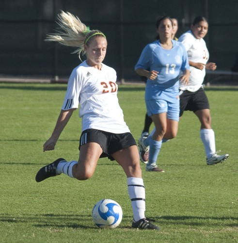 Molly Zolman, who plays as a forward and a midfielder, scores the third goal in the first half of La Verne's crushing 4-0 victory over Marymount. Zolman, a business administration major, has one of the highest goal averages on the team with an average of one goal for every two attempts this season. This gives the women their first win of the season. / photo by Warren Bessant