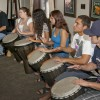 Steve Biondo, far left, leads his students, Brooke Ball, Paola Portillo, Christine Serrano, Christian Robles and Zac Florez through a West African drumming lesson. The unique sounds and rhythms can be heard outside of the Hanawalt House during the week as the new drumming class meets every Wednesday. Biondo teaches traditional drumming techniques to three different groups throughout the day. / photo by Christopher Guzman
