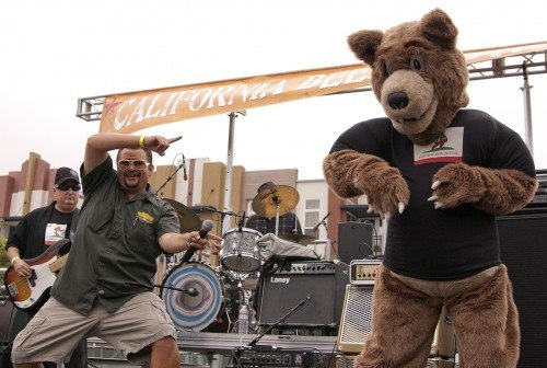 Bo Jaxon hosted the California Beer Festival in Claremont, Saturday October 16 while festival mascot, Burt the Bear, walked the event and posed for pictures. Jaxon is a radio disc jockey from Ventura. He is the host of the Bo and Friends Morning Show on B95.1 FM and was also the host of the first California Beer Festival that took place in the Ventura. Jaxon noted that because of the event's success in both cities, promoters would like to see it happen every year in Ventura and Claremont. / photo by Christopher Guzman