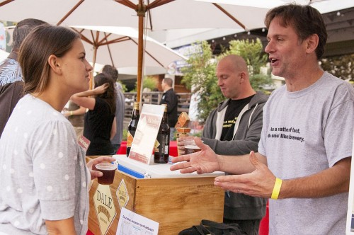 Andy Dale, co-owner of the Dale Bros. Brewery of Upland, was happy to enlighten Stefanie Burgos of Claremont about the glass of California Black Beer that she was sampling. The Black Beer was one of the Dale Bros. gold medal craft beers that were available on tap. / photo by Christopher Guzman