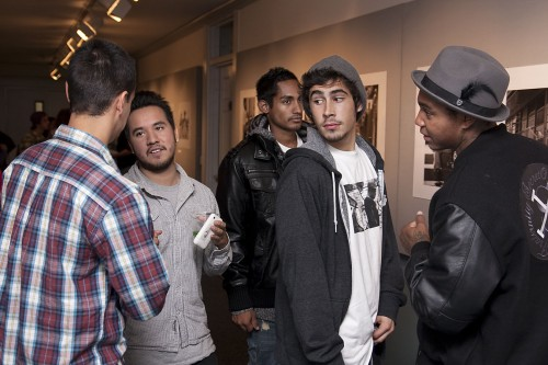 Photographer Herman Jimenez, second from the left, thanks friends Victor Rios, Ever Ortiz, James Fitzgerald and Terrell Robinson for attending his reception in the Irene Carlson gallery on Oct. 21. Clip Mission is a collection of black and white photographs portraying the people and the production of professional skateboarding in Southern California. Jimenez a graduate of ULV has traveled internationally to photograph the best skateboarding has to offer. Many of his friends are featured in the photographs. / photo by Scott Mirimanian