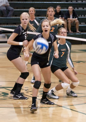Occidental defenders Aly Fritz and Logan Boyer-Hayse watch a spike from La Verne's Catie Logan, No. 7, fall for a point during the first set of their match Tuesday. The teams battled back and forth but the Leopards finished off the Tigers in the fifth set, improving their record to 15-10./ photo by Christopher Guzman