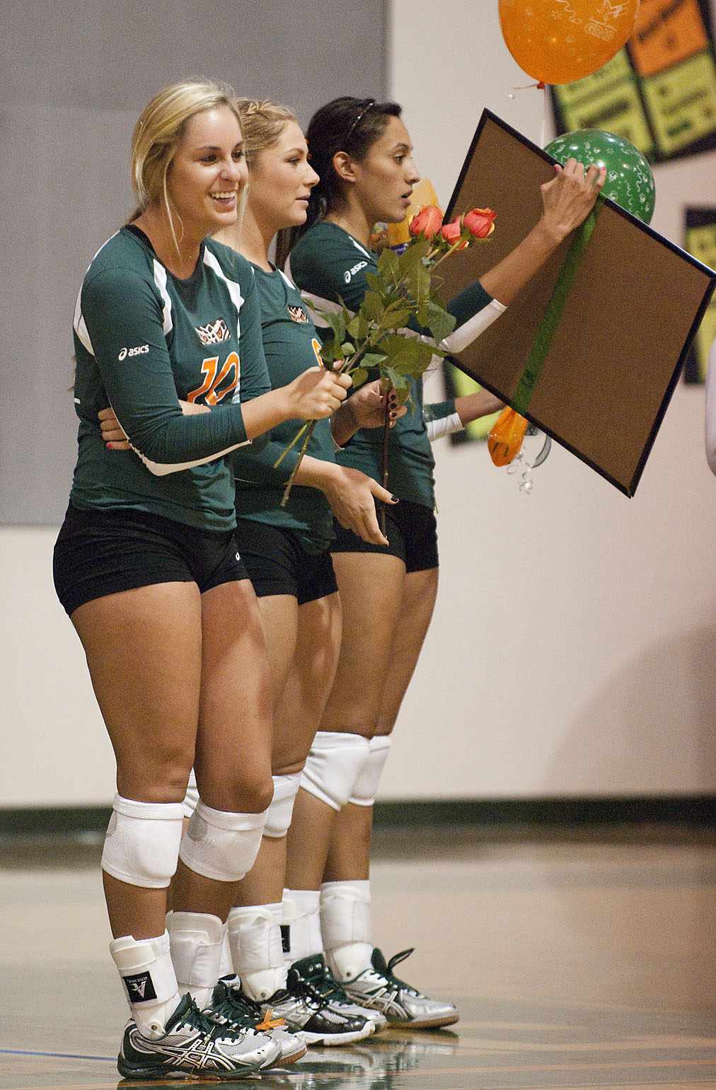 Senior volleyball players Chelsea Sleight, Anna Calmer and Colleen Moreno receive gifts during Senior Night. Senior Night is a long honored tradition that ...