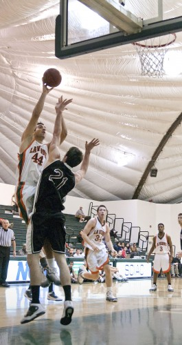 La Verne's starting center Alex Wolpe goes up for the bucket against Chapman's Ben Ricard in the first half of their matchup Wednesday night. The Leopards roared out of the locker room in the first half but couldn't hold off the Panthers as they dropped their second game of the season, 85-74. The Leopards wrap up a three game home stretch Saturday night against West Coast Baptist. / photo by Christopher Guzman