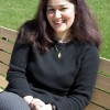 "On a bright Wednesday afternoon, Gitty Amini takes a moment from her busy day to relax in the sun on the University Mall. Amini, associate professor of political science, has several publications, including a chapter, ""Globalization and the State in the Middle East: Iran, Turkey, Israel, and the Palestinians"" in Richard Rosecrance and Arthur Stein's ""No More States? Globalization, National Self-Determination and Terrorism"" (2006). / photo by Victoria Castaneda"