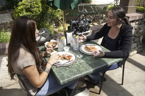 University of La Verne juniors Julissa Cardenas and Angie Marcos enjoy lunch Tuesday at Warehouse Pizza. On the corner of Bonita Avenue and D Street. Known for its delicious pizza and antipasto salads, Warehouse, which opened in 1972, is a La Verne institution. / photo by Allison Lavelle