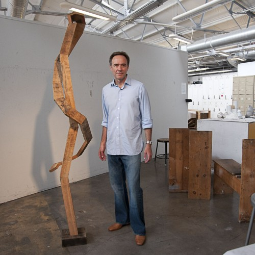 This yet-to-be-named wood sculpture represents only one facet of the artistic media used by Keith Lord, professor of art.  Lord's mixed media pieces include the use of unusual household items, such as hollowed books used as containers to house miniature sculptures. Recently he has taken a turn toward the use of wood in his work. / photo by David Bess