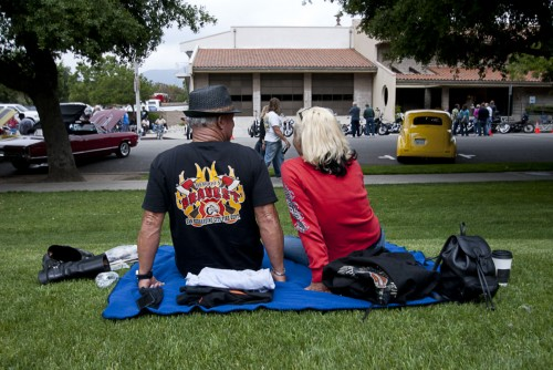 Garey and Maryanne Hummel kick off their boots and relax during the Cool Cruise Car Show in old town La Verne on Saturday. The Hummels, who have been married and riding for more than 30 years, own a motorcycle and have participated in many car shows. / photo by Candice Salazar